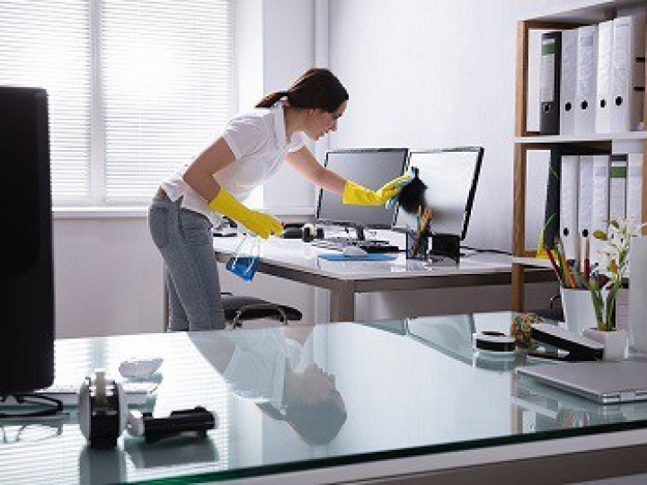 woman cleaning desk